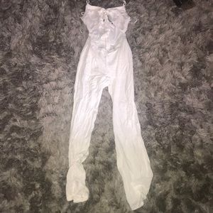 White jump suit with a opening in the stomach area